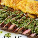 Grilled Flank Steak topped with Chimichurri alongside fried Tostones