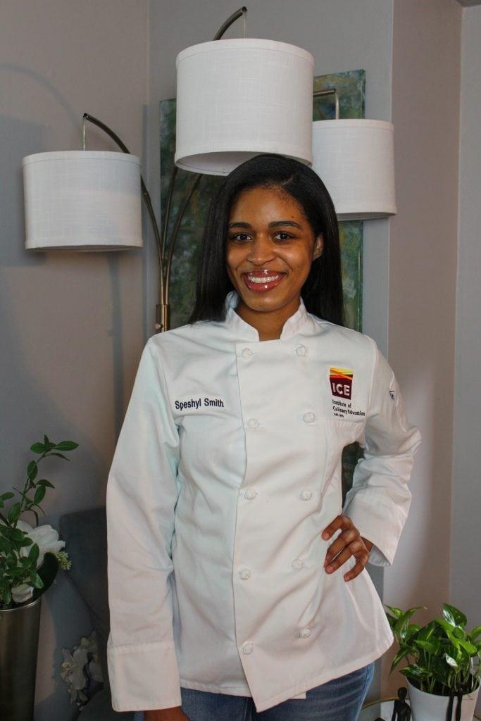 Speshyl, a culinary student in a chef coat.