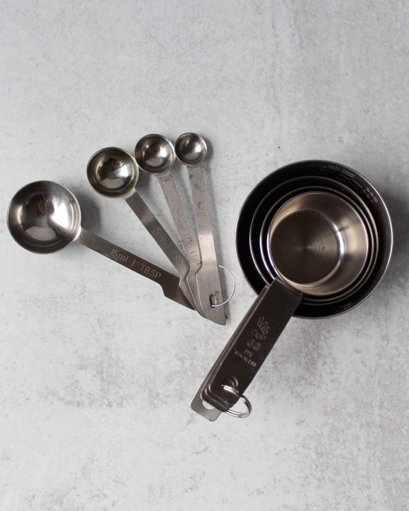 Stainless steel measuring cups and spoons. Kitchen essentials.